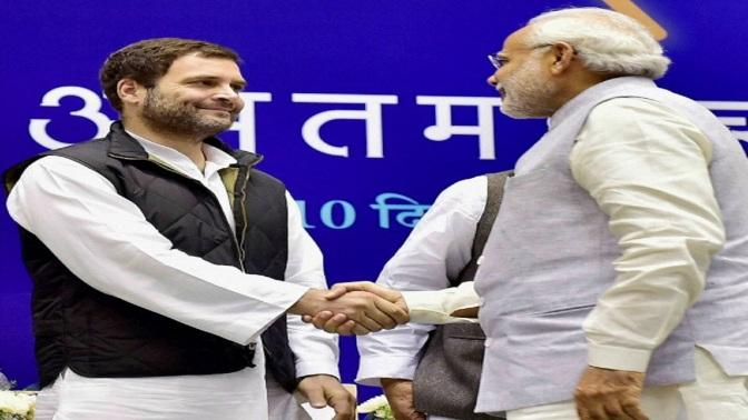 403527-pti-rahul-gandhi-and-modi-shake-hands